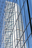 Turning Torso reflection. A reflected view of the turning torso twisted tower block in malmo Royalty Free Stock Image