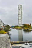 Turning Torso Skyscraper in Malmo, Sweden, editorial. MALMO - OCTOBER 24: The Turning Torso Skyscraper with reflection in a river in Malmo, Sweden on October 24 Royalty Free Stock Images