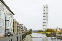 Turning Torso Skyscraper in Malmo, Sweden, editorial. MALMO - OCTOBER 24: The Turning Torso Skyscraper and a residential district in Malmo, Sweden on October 24 Stock Images