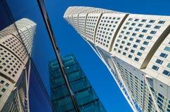 Turning Torso skyscraper. Malmo, Sweden. MALMO, SWEDEN - JUNE 05, 2011: Turning Torso skyscraper and its reflection in glass wall Stock Images