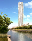 Turning Torso skyscraper view in daylight. Turning Torso skyscraper view in daylight with plants and river in the foreground. Designed by Santiago Calatrava Royalty Free Stock Photo