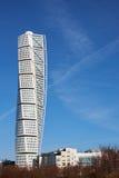 Turning torso the skysraper in malmö. MALMO, SWEDEN - MARTS 28, 2014: The skyscraper Turning Torso by Calatravas rising above an apartment building Stock Photo
