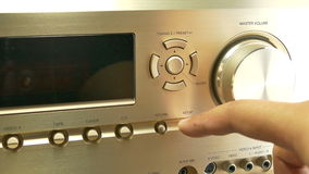 Turning up or down the volume on a av receiver , close up stock footage