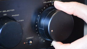 Turning The Volume Knob stock footage