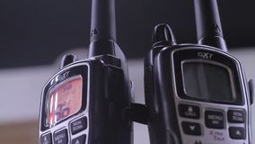 Turning On Walkie Talkies. Stock video in 4k or HD resolution stock video