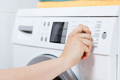 Turning on the washing machine Royalty Free Stock Photo