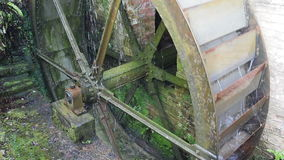 Turning Water Wheel. Renovated water mill used to turn a mill stone stock video footage
