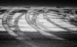 Turning wet tire tracks and line marking Stock Image