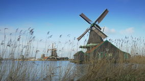 Turning windmills at the Zaanse Schans. Holland 4K stock video footage