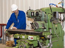 Turning work. metal processing. Turner is working on the machine.metal processing. Worker works on a lathe. Industrial area Royalty Free Stock Photos