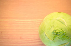 Turnip cabbage on a wood surface Stock Images