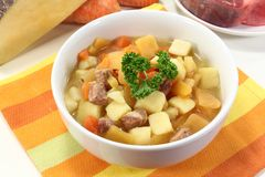 Turnip stew. A bowl of turnip stew with parsley and cook meat Stock Photo