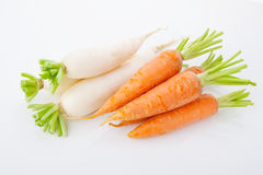 Turnips and carrots heaps Royalty Free Stock Image