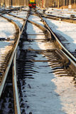 Turnouts in the foreground. Rails in the sun in the snow with turnouts in the foreground Stock Photo