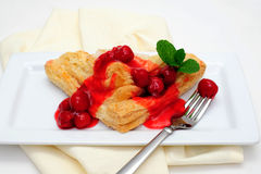 Turnover Topped With Cherries Royalty Free Stock Photo