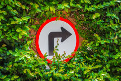 .Turns to the right sign with green leaf Stock Photography