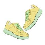Turnschuhe Schuhe des Handabgehobenen betrages Auch im corel abgehobenen Betrag Lizenzfreie Stockbilder