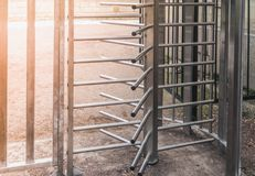 The turnstile full-height rotor electromechanical is installed at the entrance to the Gatchina Park to control and limit the trave Royalty Free Stock Image