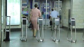Turnstile in metro. People in subway stock video