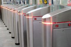 Turnstiles at the entrance to the metro. Closeup photo stock photos