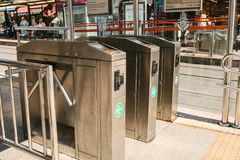 Istanbul, June 16, 2017: Turnstiles at the entrance to the station against the background of blurred public transport Stock Images