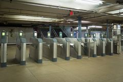 Turnstiles with no people walking in the station showing commute. th Station run by Port Authority runs trains royalty free stock photo