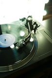 Turntable arm over vinyl with backlight Royalty Free Stock Photos