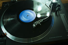 Turntable arm over vinyl with backlight Royalty Free Stock Image