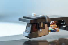 Turntable black vinyl Headshell Cartridge closeup macro Royalty Free Stock Photo