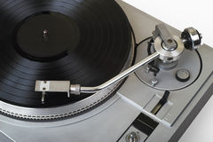 Turntable with disk on white. 20-years old turntable is stylish now as before. There is a disk with blank label. You may put logo or text on it. Clipping path Stock Image