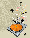 Turntable and flowers Stock Photos