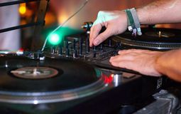 Turntable, hand of dj on the vinyl record Royalty Free Stock Image