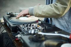 Turntable, hand of dj on the vinyl record Stock Images