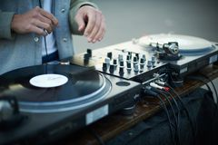 Turntable, hand of dj on the vinyl record Stock Image
