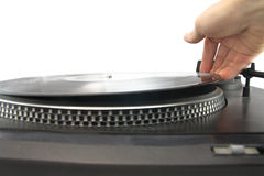 Turntable and hand putting vinyl record Stock Images
