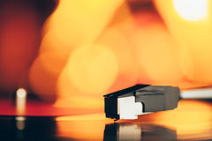 Turntable with LP vinyl record against burning fire Royalty Free Stock Photos
