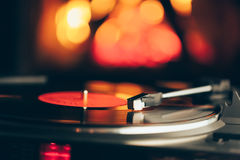 Turntable with LP vinyl record against fire background Royalty Free Stock Photography