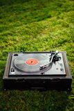 Turntable with LP vinyl record on grass background Stock Photography