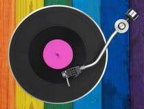Turntable nad kolorowymi drewnianymi deskami Obraz Stock