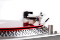 Turntable needle on a red plate Stock Photo