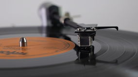 Turntable. The needle rises at the end of the vinyl disc stock footage