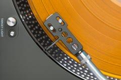 Turntable with orange vinyl record Stock Photography