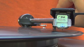 Turntable player,dropping stylus needle on vinyl record playing.  stock video