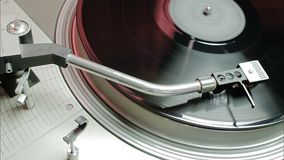 Turntable player. vinyl record playing. Turntable player,dropping stylus needle on vinyl record playing stock footage