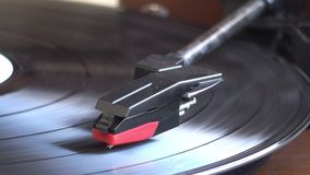 Turntable player. Turntable player,dropping stylus needle on vinyl of a spinning record playing stock footage