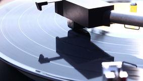 Turntable player. Vinyl rotating on a turntable, close up stock video footage