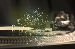 Turntable playing classical music with icon drawn instruments Stock Photography