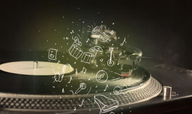 Turntable playing classical music with icon drawn instruments. Concept on background Stock Photography