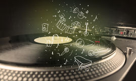 Turntable playing classical music with icon drawn instruments. Concept on background Stock Images