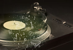 Turntable playing classical music with icon drawn instruments Royalty Free Stock Photo